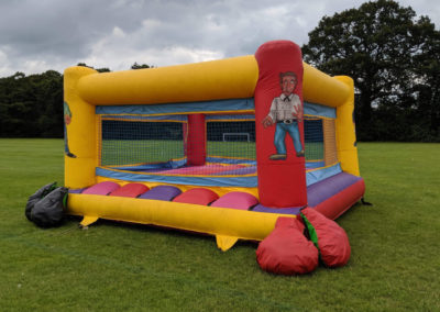 Inflatable boxing ring and giant gloves